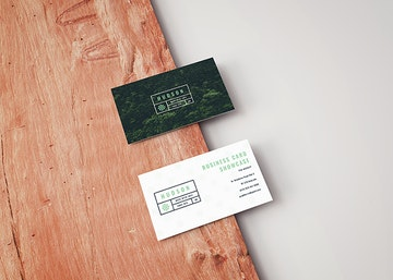 Free Business Card Mockup on a Wooden Board